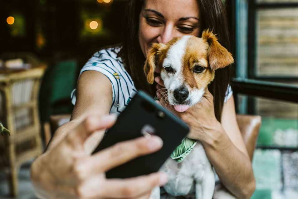 Picture of a woman taking a selfie with her dog